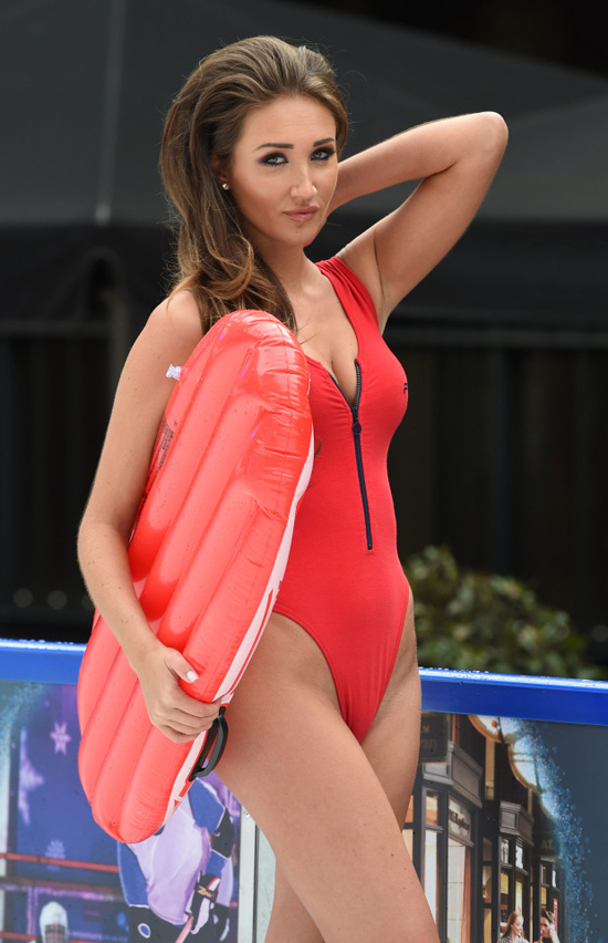 Megan is giving us quite a bit of eye candy in her revealing Baywatch style swimsuit