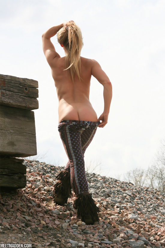 Girl pulling down her trousers