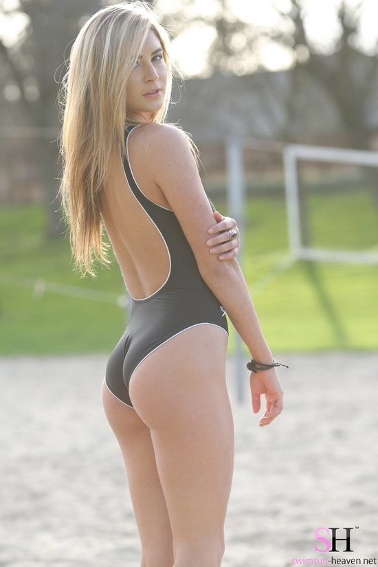 Blonde cutie in a tight black swimsuit