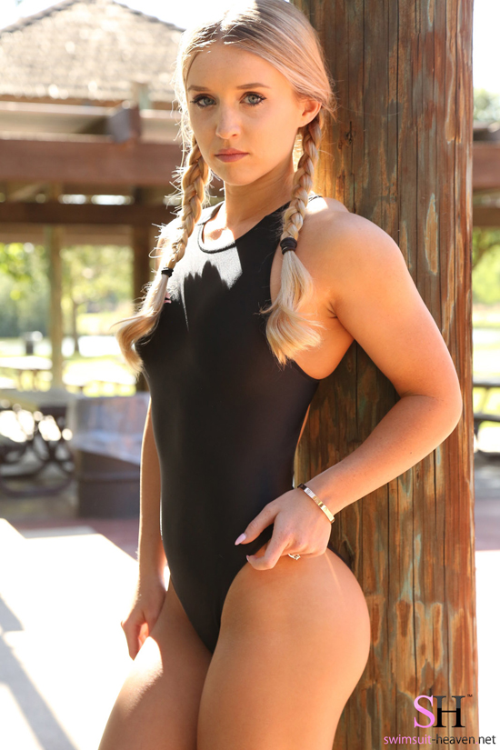 Girl in a swimsuit with pig tails