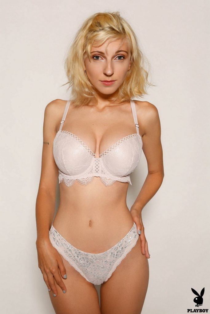Blonde girl posing in her underwear for a casting call