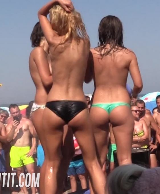 Girls strip topless during a wet t-shirt contest
