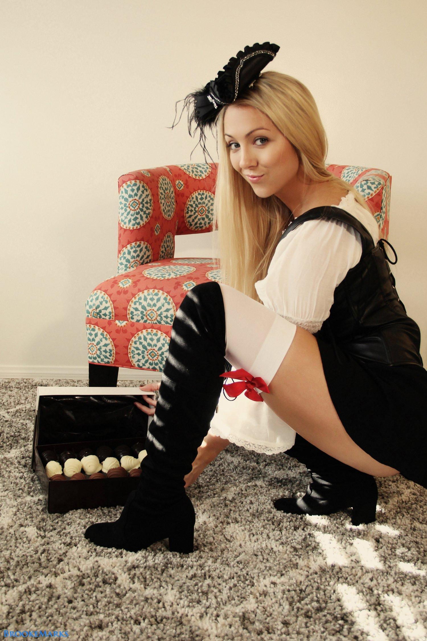 Brooke Marks in leather basque and black boots