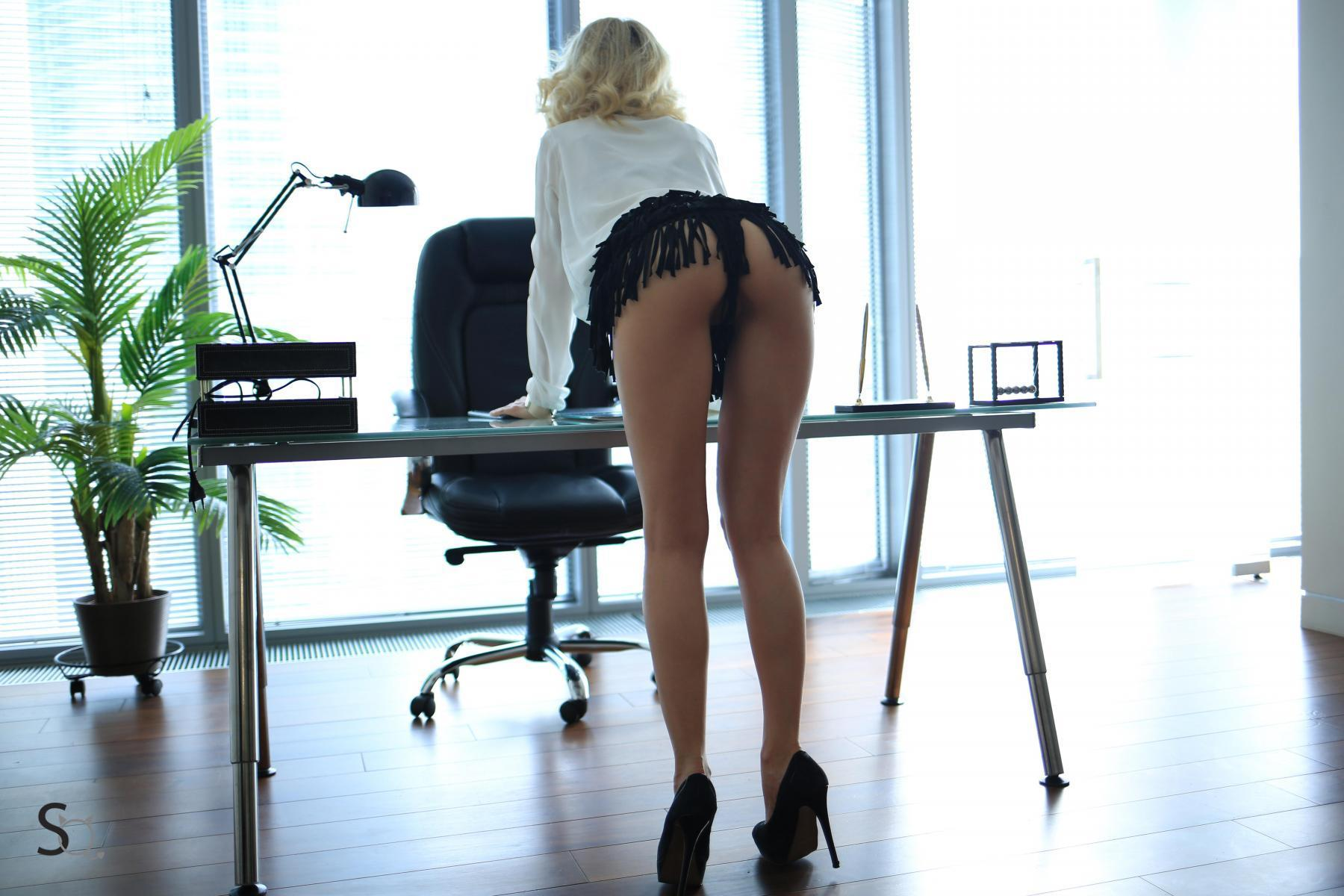 MonroQ leaning on her desk with a fantastic view of her cute ass
