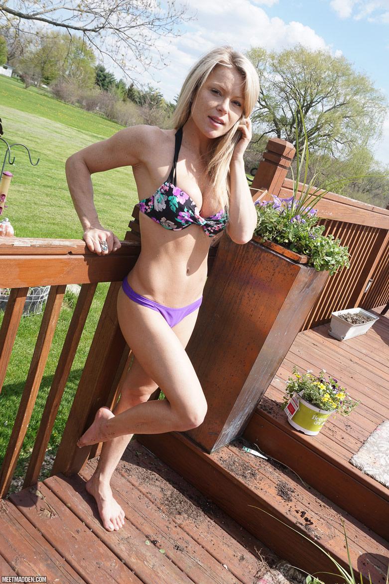 Meet Madden standing outdoors in just her bra and panties