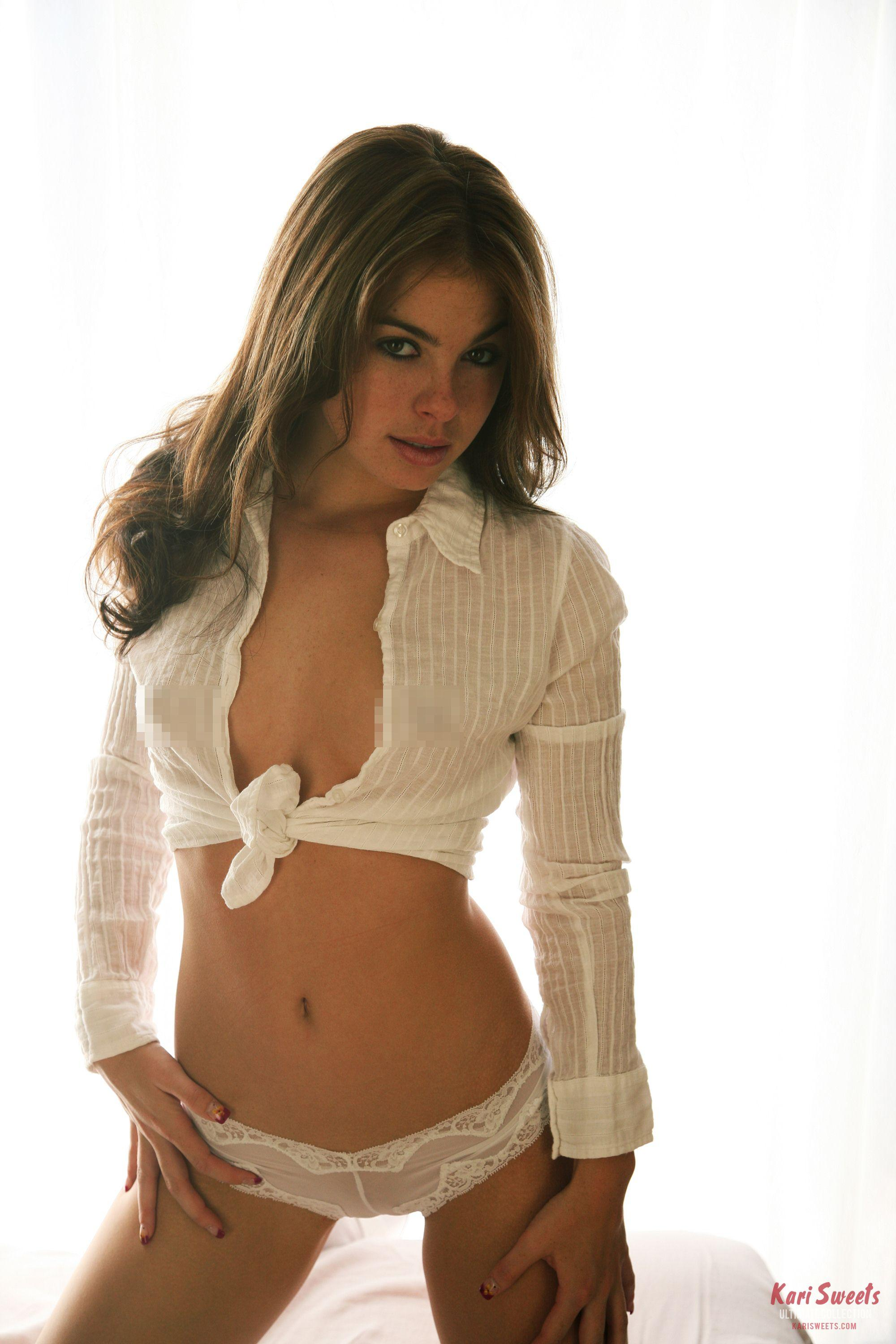 Kari Sweets gives a sexy stare in her white top and panties