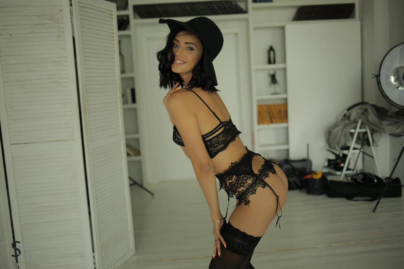 AshleyQ leaning forward in a black lingerie-StasyQ