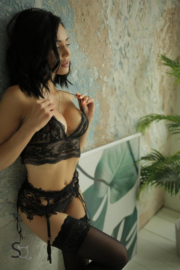 AshleyQ leaning against a wal in a black lingerie-StasyQ