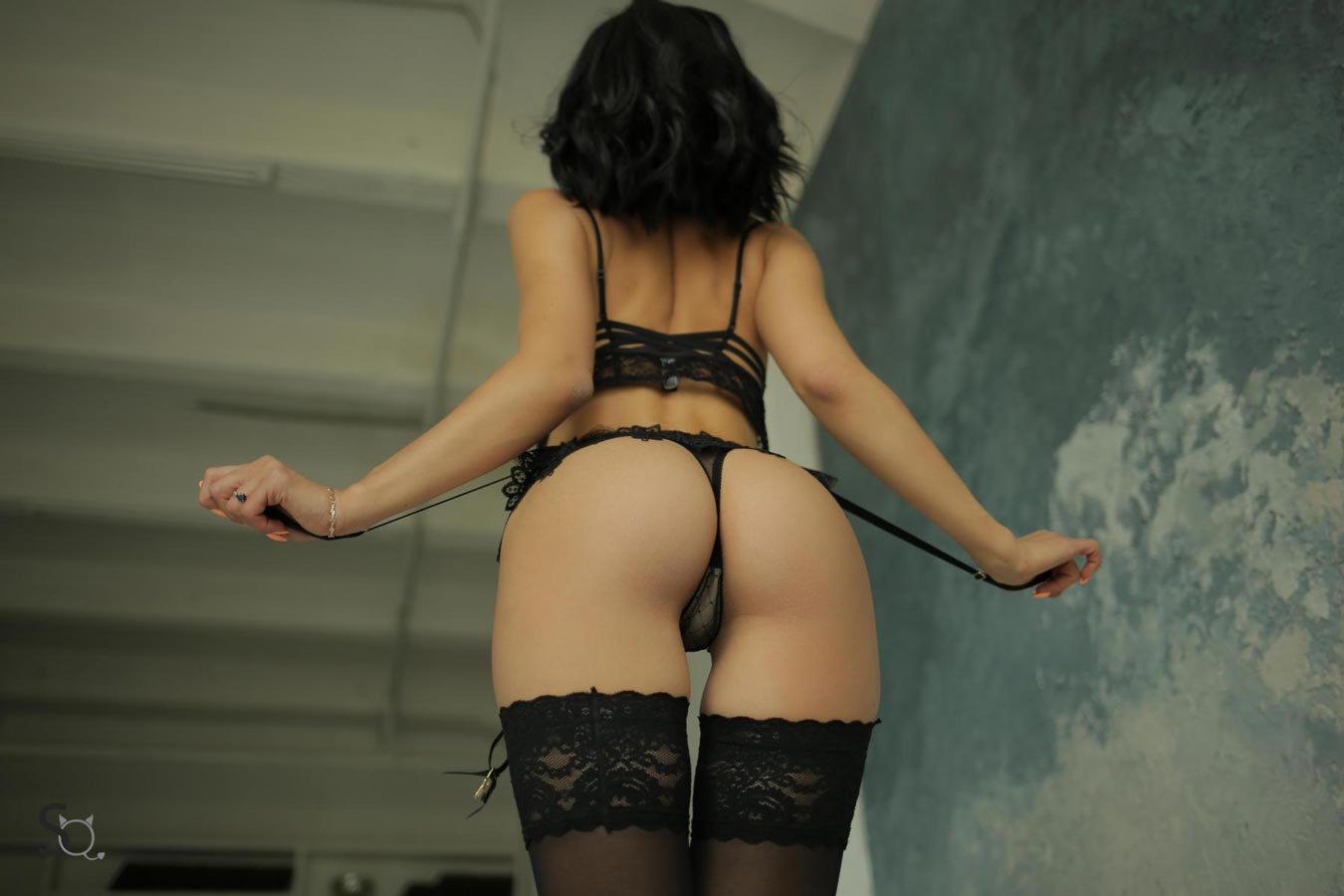 AshleyQ giving a nice close up of her sexy bum in black lingerie and stockings-StasyQ