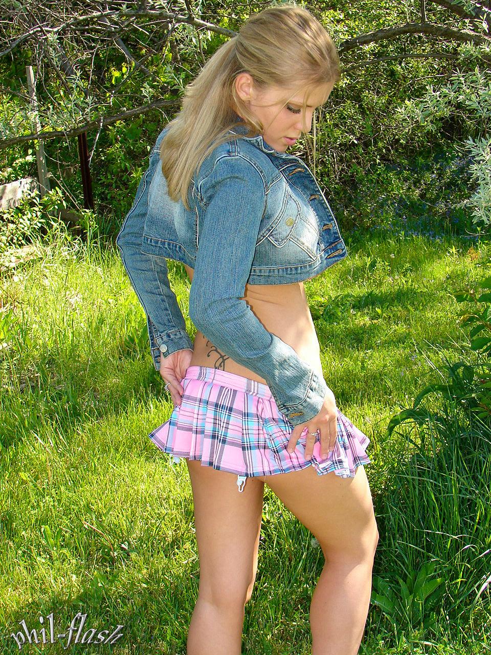 Blonde girl outdoors in a miniskirt