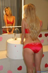 Brooke Marks looks in the mirror while showing off her sexy ass