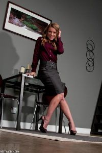 Blonde hottie poses as the hot office secretary