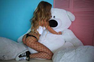 Miaq enjoying herself as she plays with a big teddy bear for Stasyq