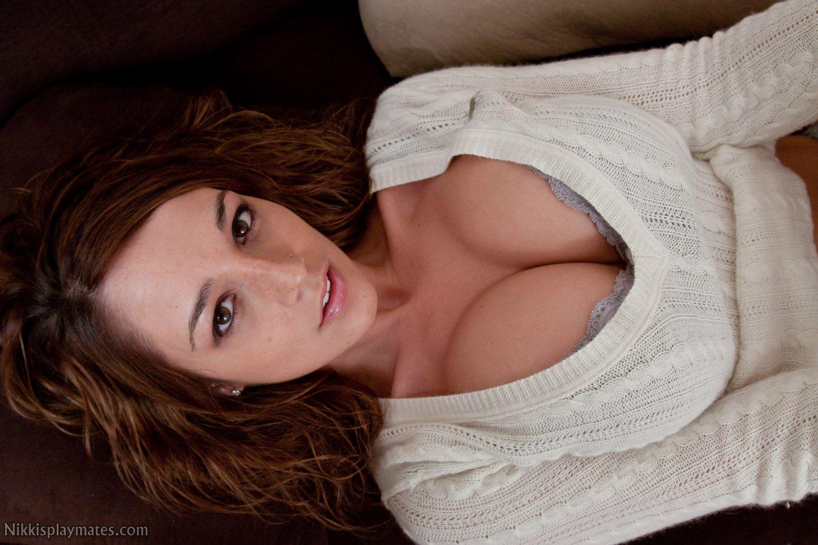 She lays back and shows her wonderful cleavage