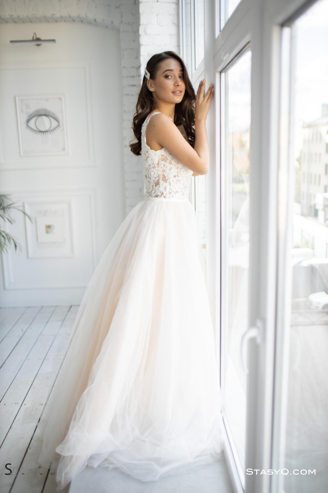 MedinaQ in her wedding dress