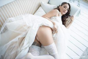 Brunette lifts up her wedding dress and shows her sexy panties