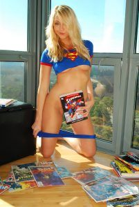 Super heronine pulls down her panties and covers herself with a surer hero magazine