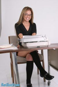 Naughty office secretary Kari Sweets sits behind her typewriter