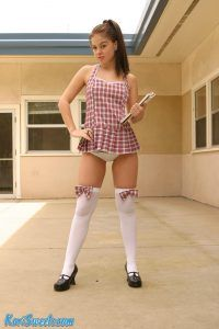Naughty Kari Sweets is dressed to thill in her plaid mini dress