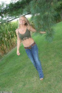 Meet Madden enjoying the outdoors in her sexy jeans and short green top