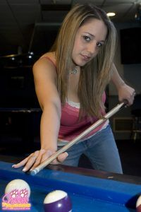 Sexy Nikki Sims bends over the pool table to take a shot