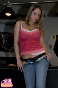 Naughty Nikki slowly pulls down the front of her jeans and reveals her sexy black panties