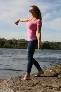 Sexy Meet Madden standing outdoors in her pink top and tight jeans