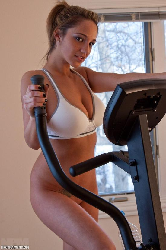 She starts her excerises with a cross trainer routine in just her white bra, completely bottomless