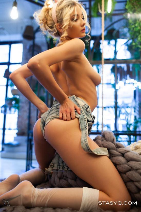 Blonde hottie pulls up her denim shorts to show her firm butt cheeks