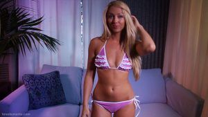 Sexy Brooke Marks standing in her purple bra and panties