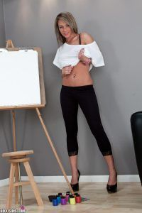 Nikki Sims gets ready for art class in her white top and sexy tight black pants