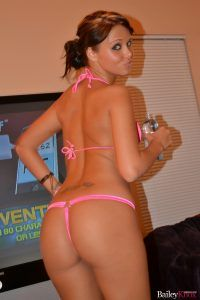 She turns to show her gorgeous butt in her pink bikini bottoms