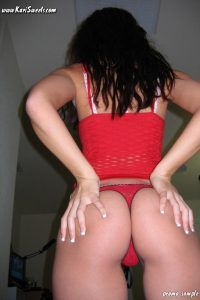 Brunette girl turns to show off her sexy ass cheeks in red panties