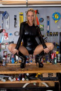 Naughty Miss Sims gives a wonderful pose as she sits on the garage work surface with her legs spread