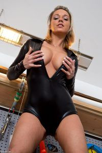 She opens her leather suit and shows off her wonderful cleavage