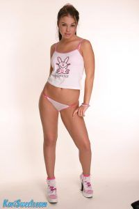 Sexy Kari Sweets standing in her short t-shirt and panties
