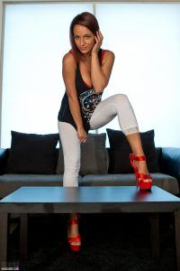 Nikki Sims looking fabulous in her white leggings and red high heels