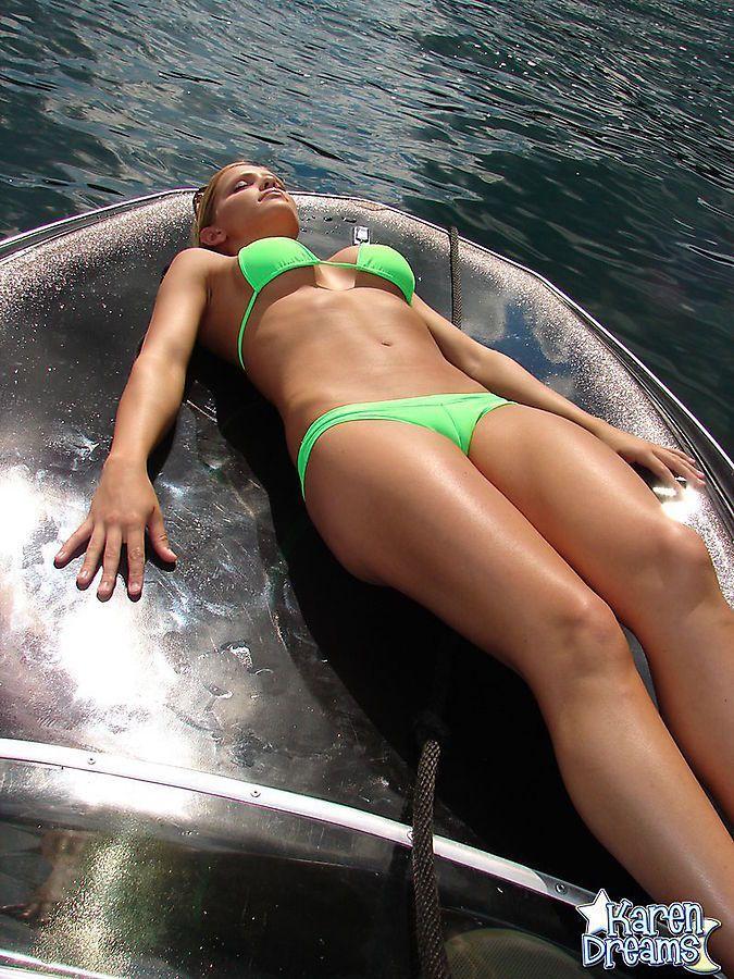 She's soaking up the sunshine in her sexy green bikini