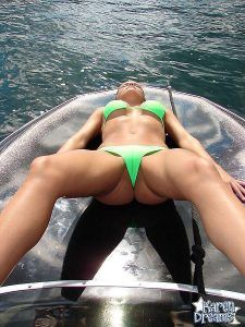 Naughty blonde girl laying back on her boat with her legs spread for a very nice cameltoe view