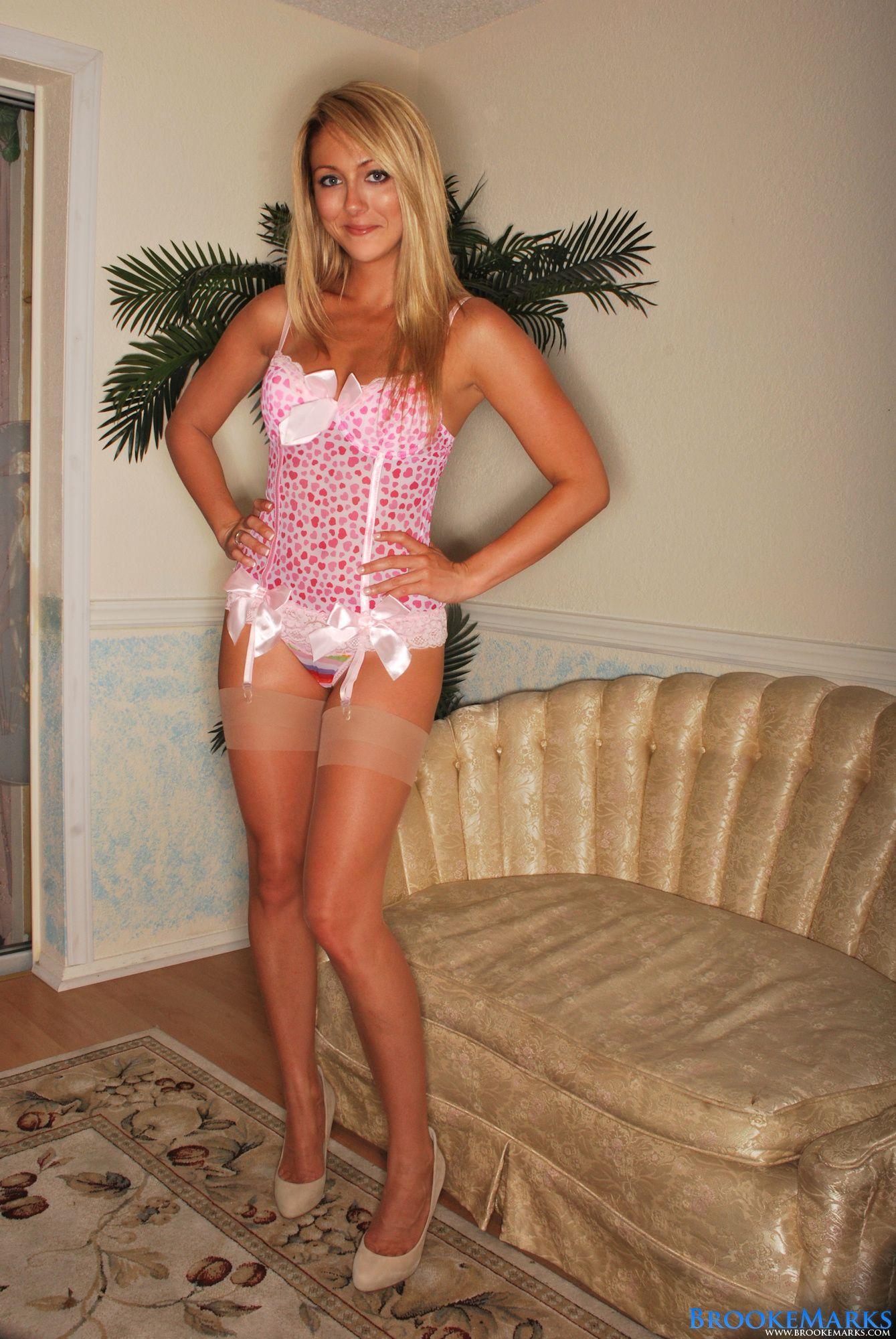 Blonde hottie standing in her sexy love heart lingerie