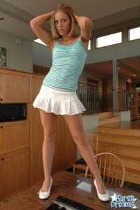 Sexy Karen Dreams standing on her kitchen table in her sexy blue top and white mini skirt
