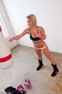 Blonde Nikki throwing a few punches towards her punchbag