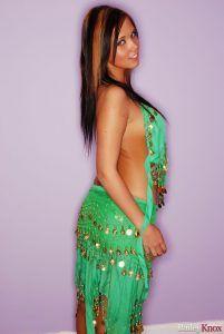 Beautiful Bailey Knox teasing in her green belly dancer dress