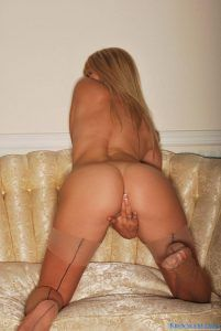 Naughty blonde coed bending over and touching herself between her legs