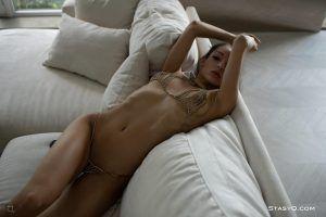 Stunning brunette giving a saucy nip slip in her kinky bra and panties
