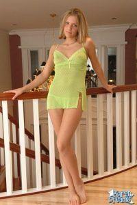 Beautiful Karen Dreams standing in her green see thru nighty and panties