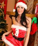 Christmas Girl in Pantyhose Lifts her Skirt